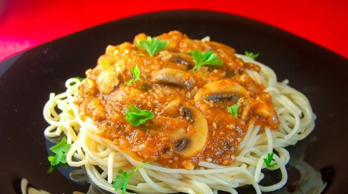 Red pasta with dried mushrooms for pasta