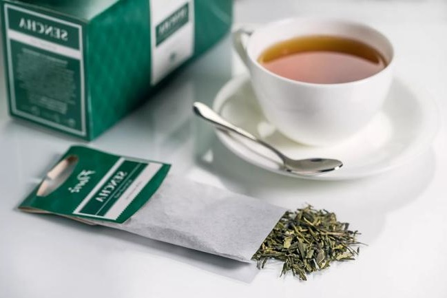 a cup of green tea bags